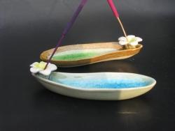 Ceramic Frangipani on 'boat'